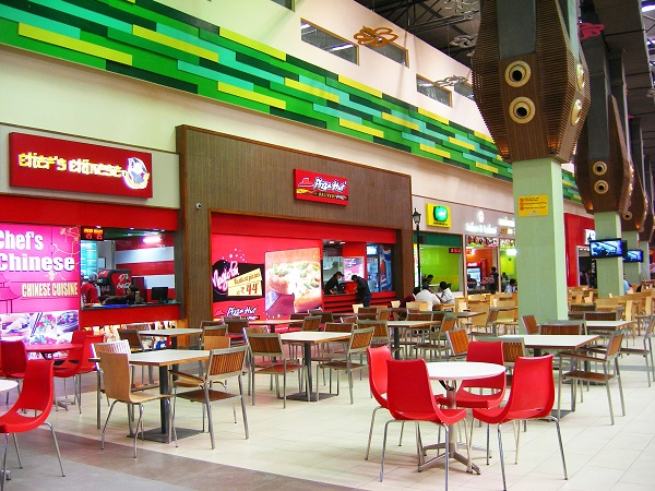 An Image Of LED Screen Display In Food Court At Shopping Mall.